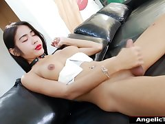 Big tits Asian shemale Milk B spreads ass and jerks off cock
